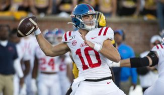 Mississippi quarterback John Rhys Plumlee throws a pass during the first half of an NCAA college football game against Missouri Saturday, Oct. 12, 2019, in Columbia, Mo. (AP Photo/L.G. Patterson)
