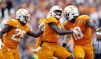 Tennessee defensive back Kenneth George Jr. (41) celebrates with defensive backs Trevon Flowers (25) and Nigel Warrior (18) after intercepting pass in the first half of an NCAA college football game against Mississippi State, Saturday, Oct. 12, 2019, in Knoxville, Tenn. (AP Photo/Wade Payne)