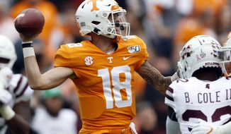 Tennessee quarterback Brian Maurer (18) throws to a receiver in the first half of an NCAA college football game against Mississippi State, Saturday, Oct. 12, 2019, in Knoxville, Tenn. (AP Photo/Wade Payne)