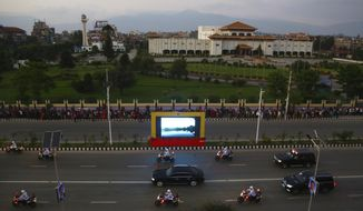 The motorcade of Chinese President Xi Jinping  drives past the Nepalese parliament in Kathmandu, Nepal, Saturday, Oct 12, 2019. Xi has become the first Chinese president in more than two decades to visit Nepal, where he's expected to sign agreements on major infrastructure projects. (AP Photo/Niranjan Shrestha)