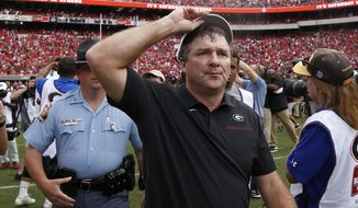 Georgia head coach Kirby Smart leaves the field after losing 20-17 in double overtime to South Carolina in an NCAA college football game Saturday, Oct. 12, 2019, in Athens, Ga. (AP Photo/John Bazemore)