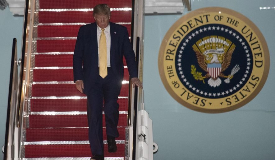 President Donald Trump departs Air Force One early Saturday, Oct. 12, 2019, at Andrews Air Force Base, Md., after returning from a campaign rally in Louisiana. (AP Photo/Kevin Wolf)