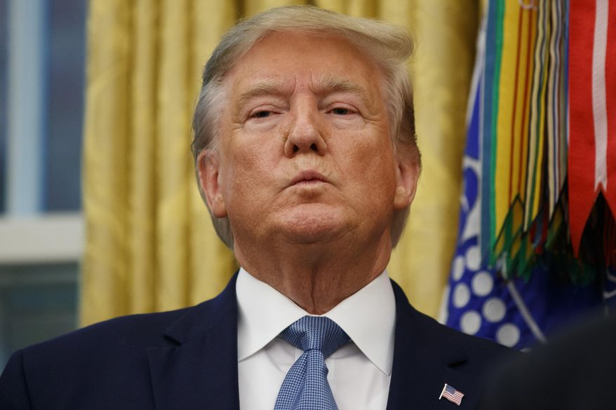 President Donald Trump stands during a ceremony to present the Presidential Medal of Freedom to former Attorney General Edwin Meese, in the Oval Office of the White House, Tuesday, Oct. 8, 2019, in Washington. (AP Photo/Alex Brandon)