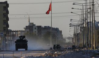 A Turkish police armored vehicle patrols the town of Akcakale, Sanliurfa province, southeastern Turkey, at the border with Syria, Saturday, Oct. 12, 2019. The towns along Turkey's border with northeastern Syria have been on high alert after dozens of mortars fired from Kurdish-held Syria landed, killing several civilians. (AP Photo/Lefteris Pitarakis)
