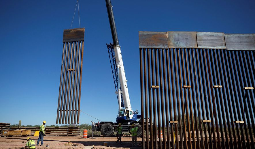 A federal court in Texas ruled that President Trump's border emergency proclamation issued in February, which he's using to siphon Pentagon money for the border wall, is illegal. (Associated Press photographs)