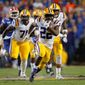 LSU running back Clyde Edwards-Helaire carries for 57 yards in Saturday's win against Florida in a matchup of previously unbeaten teams. LSU moved up to No. 2 in the poll. (Associated Press)