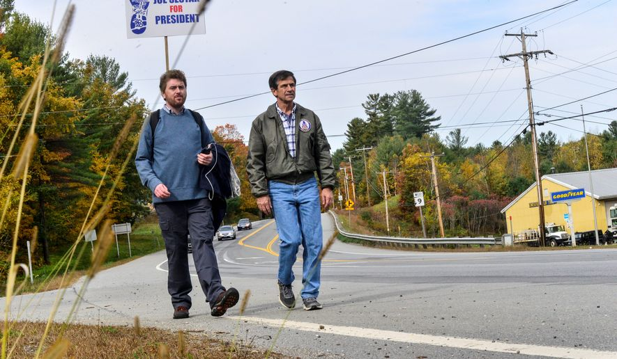 Democratic presidential candidate and former U.S. Rep. Joe Sestak, right, walks State Route 9, in Chesterfield, N.H., Sunday, Oct. 13, 2019, as he starts to make his way across the state, visiting towns along the way. (Kristopher Radder/The Brattleboro Reformer via AP)