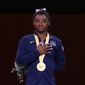 U.S. gymnast Simone Biles won her 24th and 25th world championship medals Sunday to put her on top of the all-time medal charts for the championships. (Associated PRess)