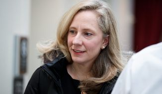Rep. Abigail Spanberger, Virginia Democrat, wrote an op-ed with six other freshman Democrats about why the Ukraine incident crossed a line that other allegations didn't. (Associated Press)