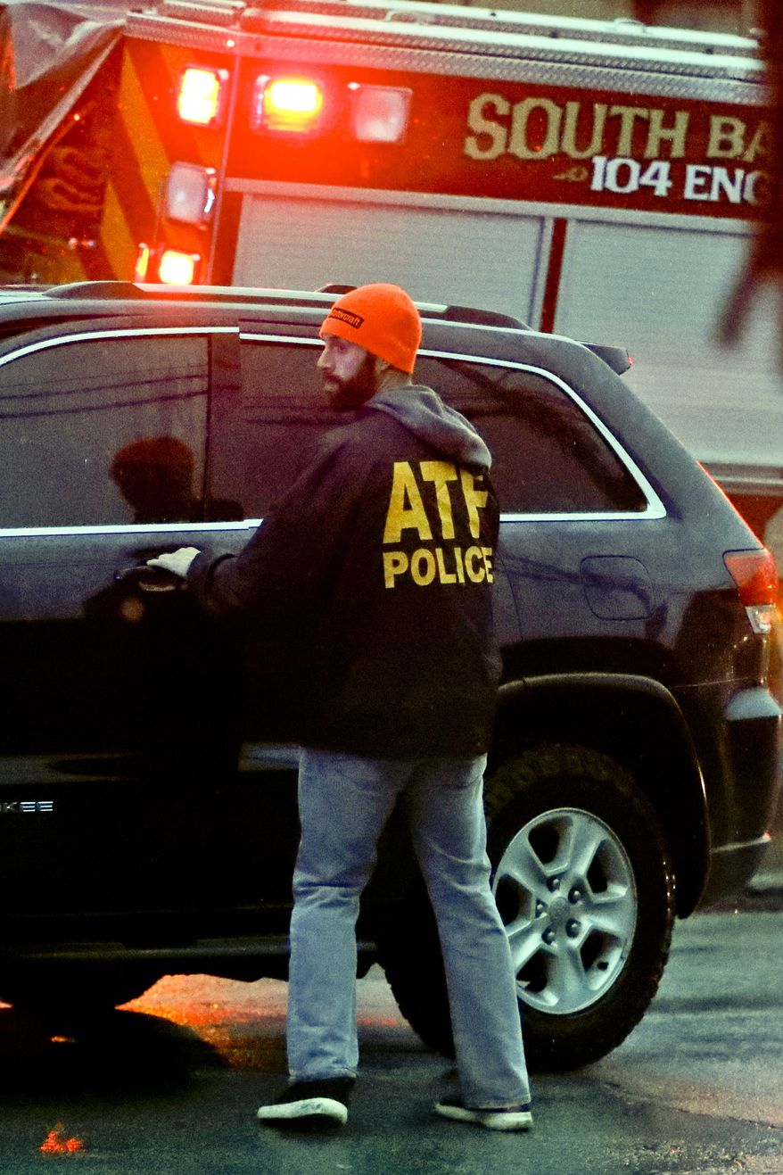 An ATF policeman goes to a vehicle as law enforcement and first responders block off the area around the McAnulty Acres apartment complex, as authorities continue their investigation of a shooting in a Pittsburgh synagogue where multiple people were killed, on Saturday, Oct. 27, 2018, in Baldwin, Pa., a suburb south of Pittsburgh. (AP Photo/Keith Srakocic) ** FILE **