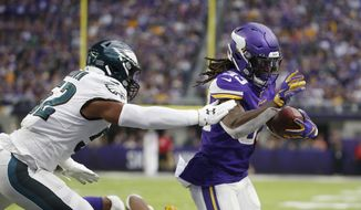 Minnesota Vikings running back Dalvin Cook scores on a 1-yard touchdown run ahead of Philadelphia Eagles inside linebacker Zach Brown, left, during the second half of an NFL football game, Sunday, Oct. 13, 2019, in Minneapolis. (AP Photo/Bruce Kluckhohn) ** FILE **