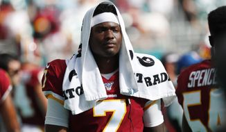 Washington Redskins quarterback Dwayne Haskins (7) walks the sidelines, during the second half at an NFL football game against the Miami Dolphins, Sunday, Oct. 13, 2019, in Miami Gardens, Fla. (AP Photo/Wilfredo Lee)