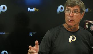 Washington Redskins interim head coach Bill Callahan speaks during a post game news conference following an NFL football game, Sunday, Oct. 13, 2019, in Miami Gardens, Fla. The Redskins defeated the Dolphins 17-16. (AP Photo/Brynn Anderson)