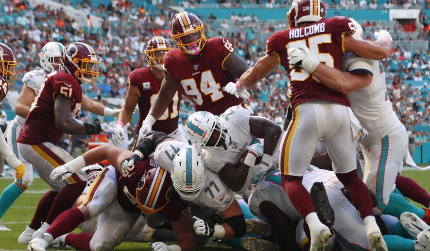 Miami Dolphins running back Kalen Ballage (27) scores a touchdown, during the second half at an NFL football game against the Washington Redskins, Sunday, Oct. 13, 2019, in Miami Gardens, Fla. (AP Photo/Wilfredo Lee)