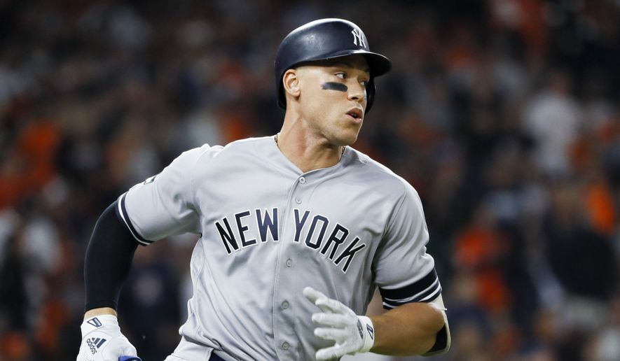 New York Yankees' Aaron Judge runs to first during the first inning in Game 1 of baseball's American League Championship Series against the Houston AstrosSaturday, Oct. 12, 2019, in Houston. (AP Photo/Matt Slocum)