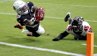 Arizona Cardinals running back Chase Edmonds (29) scores a touchdown as Atlanta Falcons linebacker Deion Jones (45) defends during the first half of an NFL football game, Sunday, Oct. 13, 2019, in Glendale, Ariz. (AP Photo/Ross D. Franklin)