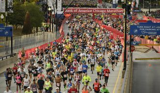 Runners start the Bank of America Chicago on Marathon Sunday, Oct. 13, 2019, in Chicago. (AP Photo/Paul Beaty)