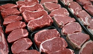 In this Jan. 18, 2010, file photo, steaks and other beef products are displayed for sale at a grocery store in McLean, Va. (AP Photo/J. Scott Applewhite, File)