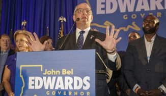 Louisiana Gov. John Bel Edwards speaks at his election night watch party in Baton Rouge, La., Saturday, Oct. 12, 2019. (AP Photo/Brett Duke)