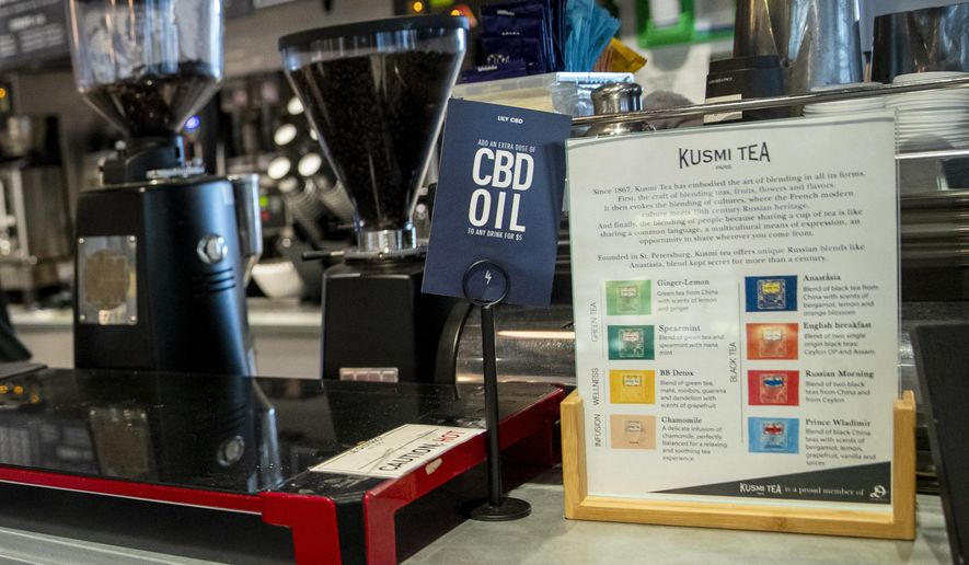 In this Tuesday, Oct. 8, 2019, photo a sign advertising shots of CBD oil available as an addition to beverages is seen on a countertop at Le District in the Financial District of New York. Food and drink spiked with the cannabis derivative CBD is still being sold in New York City, months after health officials banned it from edibles because of safety concerns. City health officials announced the CBD ban in February, but it took establishment owners by surprise, so they were offered a grace period until Oct. 1. (AP Photo/Mary Altaffer) **FILE**