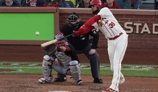 St. Louis Cardinals' Jose Martinez hits an RBI double during the eighth inning of Game 2 of the baseball National League Championship Series against the Washington Nationals Saturday, Oct. 12, 2019, in St. Louis. (AP Photo/Charlie Riedel)