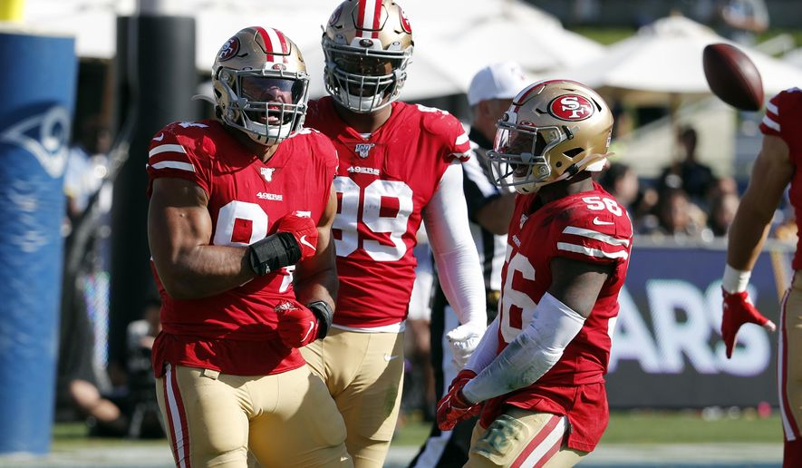 San Francisco 49ers defensive end Solomon Thomas, left, celebrates after sacking Los Angeles Rams quarterback Jared Goff during the second half of an NFL football game Sunday, Oct. 13, 2019, in Los Angeles. (AP Photo/John Locher)