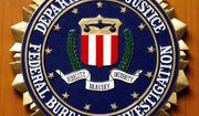 Logo of the Federal Bureau of Investigation of the Department of Justice of the United States of America pictured at the embassy of the USA in Berlin, Germany, Friday, Aug. 10, 2007. (AP Photo/Michael Sohn)