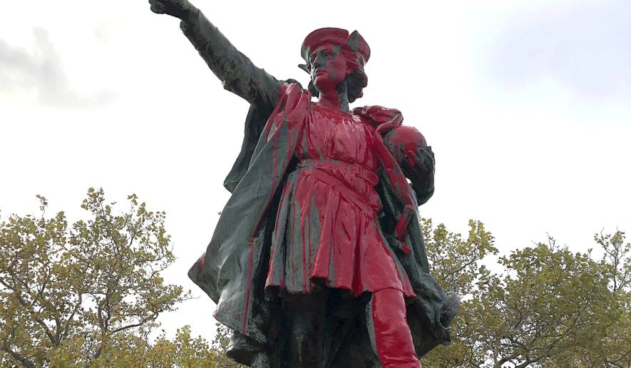 Red paint covers a statue of Christopher Columbus on Monday, Oct. 14, 2019, in Providence, R.I., after it was vandalized on the day named to honor him as one of the first Europeans to reach the New World. (AP Photo/Michelle R. Smith) ** FILE **
