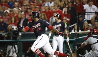 Washington Nationals' Howie Kendrick hits a two-run scoring double during the third inning of Game 3 of the baseball National League Championship Series against the St. Louis Cardinals Monday, Oct. 14, 2019, in Washington. (AP Photo/Patrick Semansky)