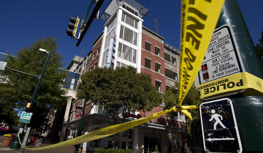 A parking garage is seen where a police officer was shot, in downtown Silver Spring, Md., Monday, Oct. 14, 2019. Police in Montgomery County, Maryland, said they were searching for at least one person after an officer was found shot in a parking garage in downtown Silver Spring on Monday. (AP Photo/Jose Luis Magana)