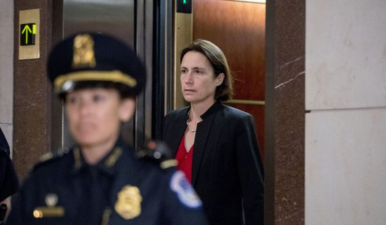 Former White House advisor on Russia, Fiona Hill, arrives on Capitol Hill in Washington, Monday, Oct. 14, 2019, as she is scheduled to testify before congressional lawmakers as part of the House impeachment inquiry into President Donald Trump.  (AP Photo/Andrew Harnik)