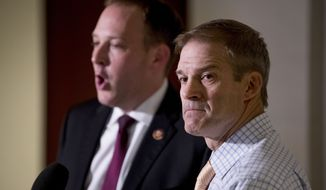 Rep. Jim Jordan, R-Ohio, ranking member of the Committee on Oversight Reform, right, and Rep. Lee Zeldin R-N.Y., left, speak to reporters following a closed-door meeting on Capitol Hill in Washington, Monday, Oct. 14, 2019, where former White House advisor on Russia, Fiona Hill, testified before congressional lawmakers as part of the House impeachment inquiry into President Donald Trump. (AP Photo/Andrew Harnik) **FILE**