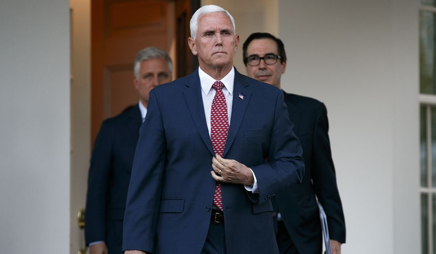 Vice President Mike Pence, center, with White House national security adviser Robert O'Brien, left, and Treasury Secretary Steven Mnuchin, left, adjusts his jacket as he approaches reporters outside the West Wing of the White House, Monday, Oct. 14, 2019, in Washington. (AP Photo/Jacquelyn Martin)