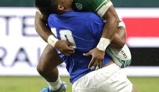 Ireland's Bundee Aki hits Samoa's Ulupano Seuteni in a high tackle during the Rugby World Cup Pool A game at Fukuoka Hakatanomori Stadium between Ireland and Samoa, in Fukuoka, Japan, Saturday, Oct. 12, 2019. Aki received a red card for this tackle. (AP Photo/Aaron Favila)