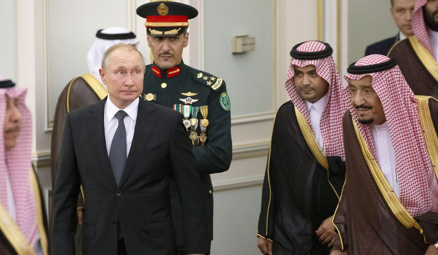 Russian President Vladimir Putin, center left, and Saudi Arabia's King Salman, right, attend the official welcome ceremony in Riyadh, Saudi Arabia, Monday, Oct. 14, 2019. Putin traveled to Saudi Arabia on Monday, meeting with the oil-rich nation's king and crown prince as he seeks to cement Moscow's political and energy ties across the Mideast. (AP Photo/Alexander Zemlianichenko, Pool)  **FILE**