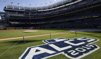 The field is prepped with signage for the American League Championship Series between the New York Yankees and the Houston Astros at Yankee Stadium, Monday, Oct. 14, 2019, in New York. Game 4 in the series, tied at 1-1, is scheduled for Tuesday. (AP Photo/Kathy Willens) ** FILE **