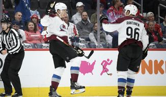 Colorado Avalanche defenseman Nikita Zadorov, left, of Russia, celebrates his goal with right wing Mikko Rantanen (96) during the first period of an NHL hockey game against the Washington Capitals, Monday, Oct. 14, 2019, in Washington. (AP Photo/Nick Wass)