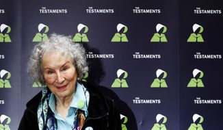 """FILE - In this Tuesday, Sept. 10, 2019 file photo, Canadian author Margaret Atwood poses for a photograph during a press conference at the British Library to launch her new book 'The Testaments' in London. Booker Prize winner Margaret Atwood is the bookies' favorite to win the coveted fiction trophy again for """"The Testaments,"""" her follow-up to dystopian saga """"The Handmaid's Tale."""" Atwood is one of six finalists for the 50,000-pound ($63,000) prize, whose winner will be announced Monday Oct. 14, 2019. (AP Photo/Alastair Grant, File)"""