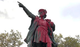 Red paint covers a statue of Christopher Columbus on Monday, Oct. 14, 2019, in Providence, R.I., after it was vandalized on the day named to honor him as one of the first Europeans to reach the New World. The statue has been the target of vandals on Columbus Day in the past. (AP Photo/Michelle R. Smith)