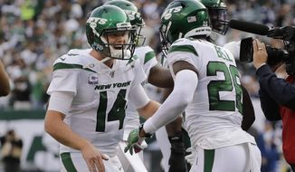 New York Jets quarterback Sam Darnold, left, celebrates with Le'Veon Bell after Bell scored a touchdown during the first half of an NFL football game against the Dallas Cowboys, Sunday, Oct. 13, 2019, in East Rutherford, N.J. (AP Photo/Frank Franklin II)
