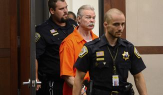 FILE - In this Aug. 5, 2019, file photo, Douglas Lovell is escorted into the courtroom for an evidentiary hearing in Ogden, Utah. The appeal hearings for a Utah death-row inmate are lasting longer than anticipated. The Ogden Standard-Examiner reported Sunday, Oct. 13, 2019, that 61-year-old Douglas Lovell was initially supposed to only have hearings in his case during the month of August. Lovell has twice been convicted of capital murder and sentenced to death for the 1985 killing of Joyce Yost. (Trent Nelson /The Salt Lake Tribune, via AP, Pool, File)