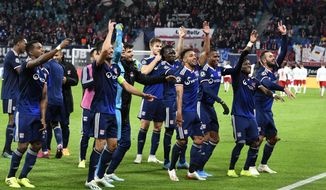 Lyon players celebrate after winning the Champions League group G first round soccer match between RB Leipzig and Olympique Lyon, in Leipzig, Germany, Wednesday, Oct. 2, 2019. (AP Photo/Jens Meyer)