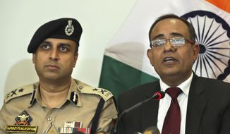 Government spokesperson Rohit Kansal, right, speaks as Swayam Prakash Pani, left, Inspector General of Police of Kashmir Range during a press conference, sits beside him in Srinagar, Indian controlled Kashmir, Saturday, Oct. 12 2019. Around 4 million post-paid cellphone connections will be restored in Indian-controlled Kashmir on Monday, more than two months after New Delhi downgraded the region's semi-autonomy and imposed a security and communications lockdown, an official said Saturday. (AP Photo/Dar Yasin)