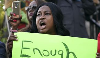 "Carol Harrison-Lafayette protests the police shooting of Atatiana Jefferson during a community vigil for Jefferson on Sunday, Oct. 13, 2019, in Fort Worth, Texas. A white police officer who killed the black woman inside her Texas home while responding to a neighbor's call about an open front door ""didn't have time to perceive a threat"" before he opened fire, an attorney for Jefferson's family said. (Smiley N. Pool/The Dallas Morning News via AP)"