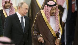 Russian President Vladimir Putin, center left, and Saudi Arabia's King Salman, right, attend the official welcome ceremony in Riyadh, Saudi Arabia, Monday, Oct. 14, 2019. (AP Photo/Alexander Zemlianichenko, Pool)