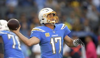 Los Angeles Chargers quarterback Philip Rivers passes during the first half of an NFL football game against the Pittsburgh Steelers, Sunday, Oct. 13, 2019, in Carson, Calif. (AP Photo/Kyusung Gong) ** FILE **