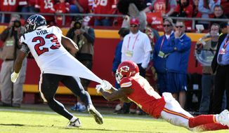 Kansas City Chiefs cornerback Bashaud Breeland (21) hangs on to the jersey of Houston Texans running back Carlos Hyde (23) during the second half of an NFL football game in Kansas City, Mo., Sunday, Oct. 13, 2019. The Houston Texans won 31-24. (AP Photo/Ed Zurga)
