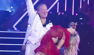 """This Sept. 30, 2019 photo released by ABC shows former White House press secretary, Sean Spicer, left, and Lindsay Arnold during the celebrity dance competition series """"Dancing With the Stars,"""" in Los Angeles. President Donald Trump tweeted Monday, Oct. 14, that viewers should vote for Spicer. The president called hima """"good guy"""" and wrote """"he has always been there for us!"""" Spicer told USA Today there's no question a """"huge"""" amount of his votes come from Trump supporters. (Eric McCandless/ABC via AP)"""