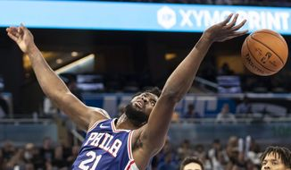 Philadelphia 76ers center Joel Embiid (21) tries to rebound the ball during the first half of a preseason NBA basketball game against Orlando Magic in Orlando, Fla., Sunday, Oct. 13, 2019. (AP Photo/Willie J. Allen Jr.)