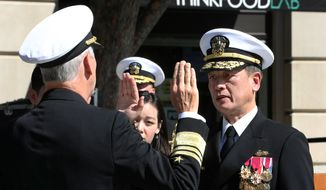 Vice Adm. Thomas J. Moore, left, administers the oath of office to Rear Adm. Huan T. Nguyen during Nguyen's promotion ceremony at the U.S. Navy Memorial & Heritage Center, Oct. 10, 2019. Nguyen is the first Vietnamese-American promoted to the rank of rear admiral and will serve as the deputy commander for Cyber Engineering at Naval Sea Systems Command (NAVSEA) at the Washington Navy Yard. (U.S. Navy photo by Laura Lakeway/Released)